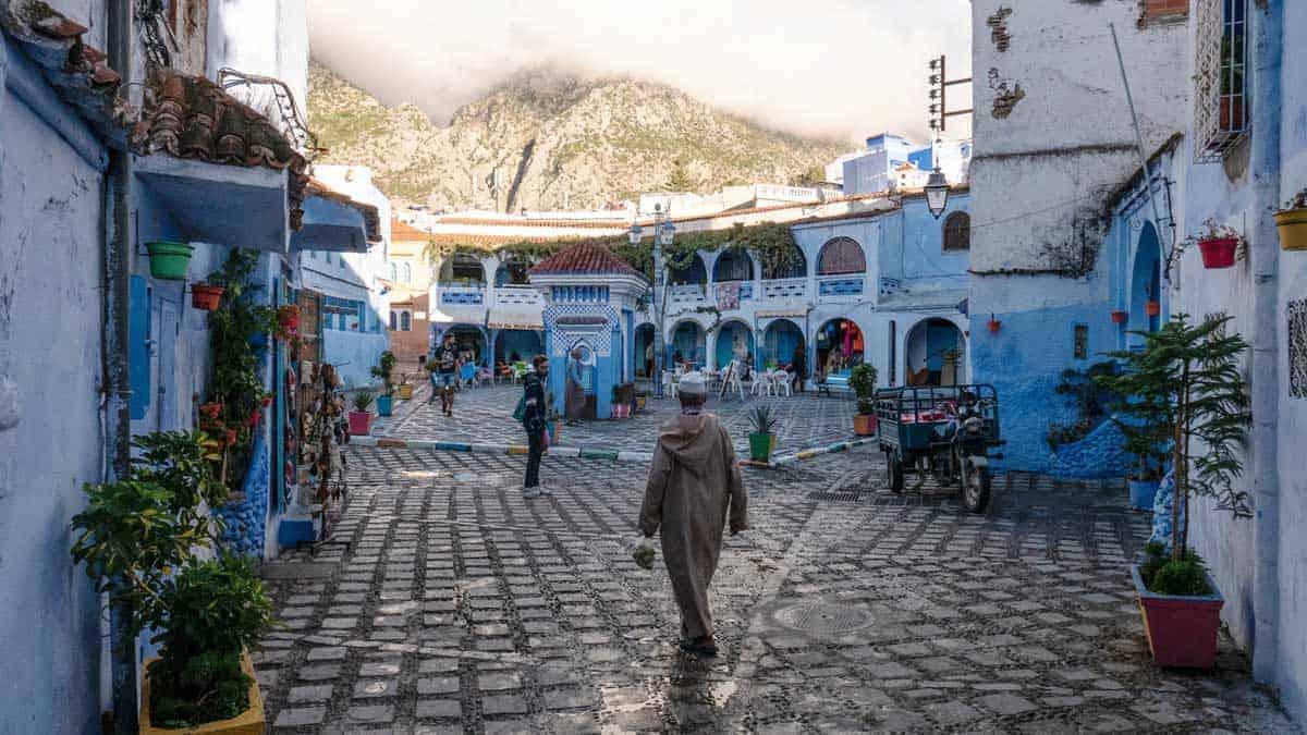 Blue walls and restaurants inside the Chefchaouen medina.