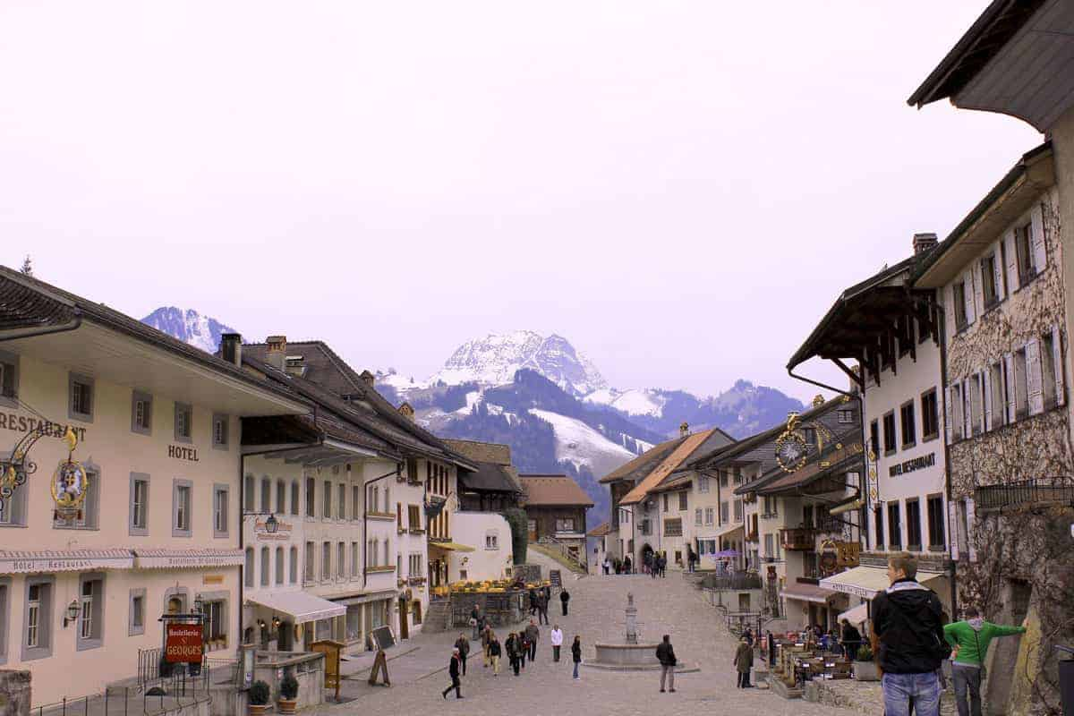 Snow capped mountains overlook Gruyeres old town