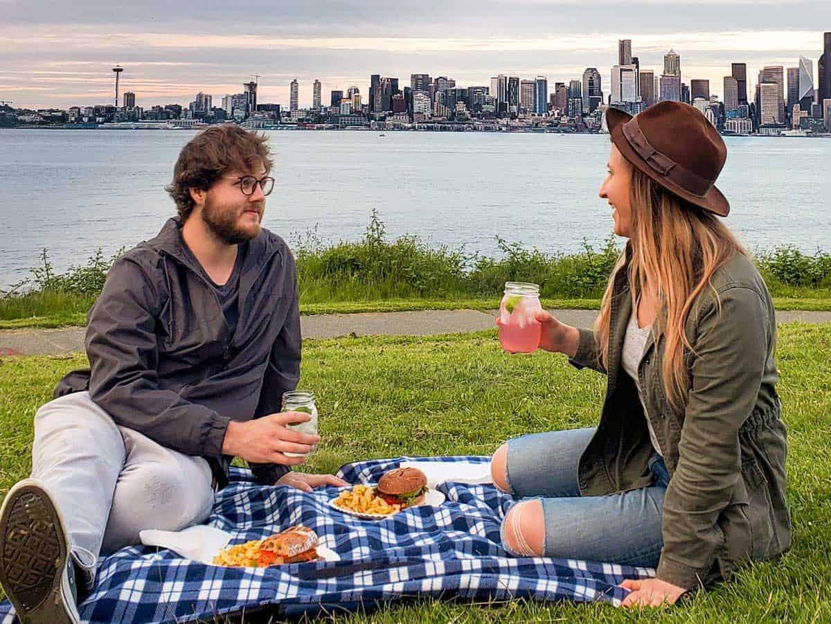 A couple having a spring picnic at Alki Beach.