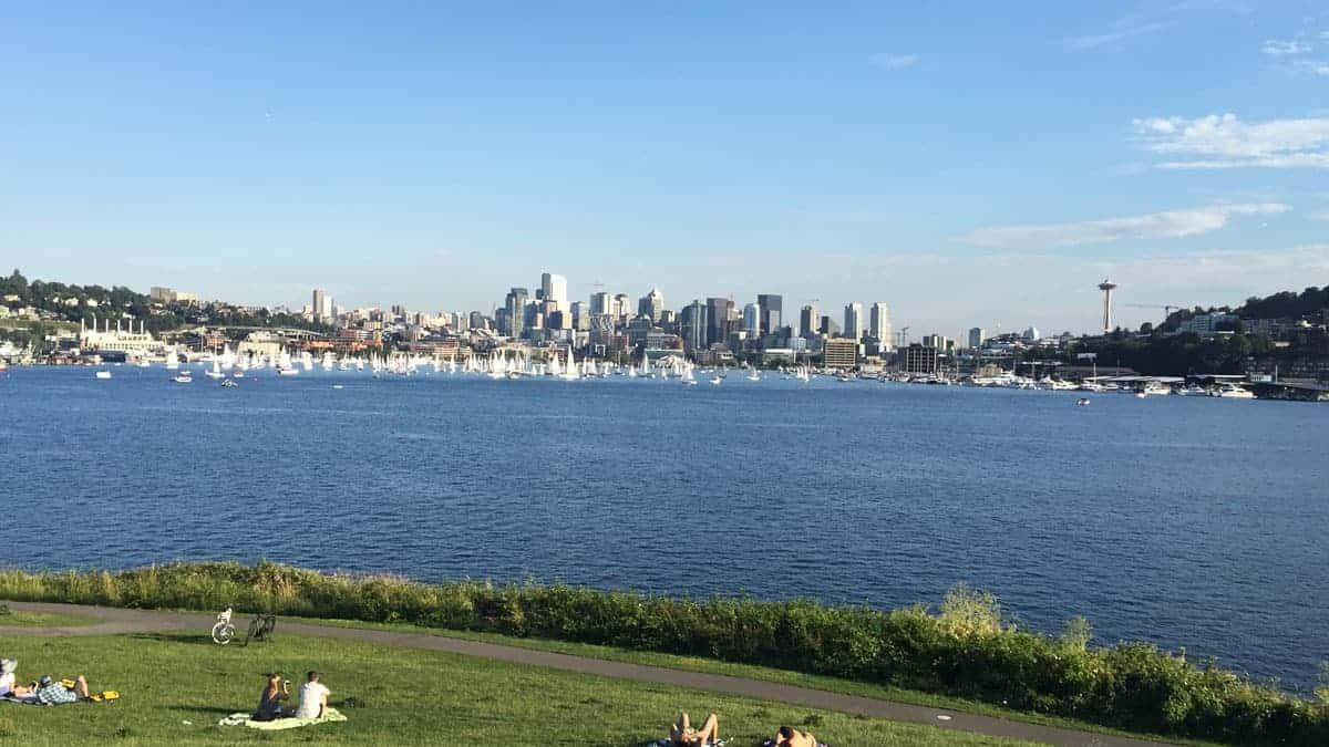 People having a picnic in Gas Works Park overlooking Seattle city.