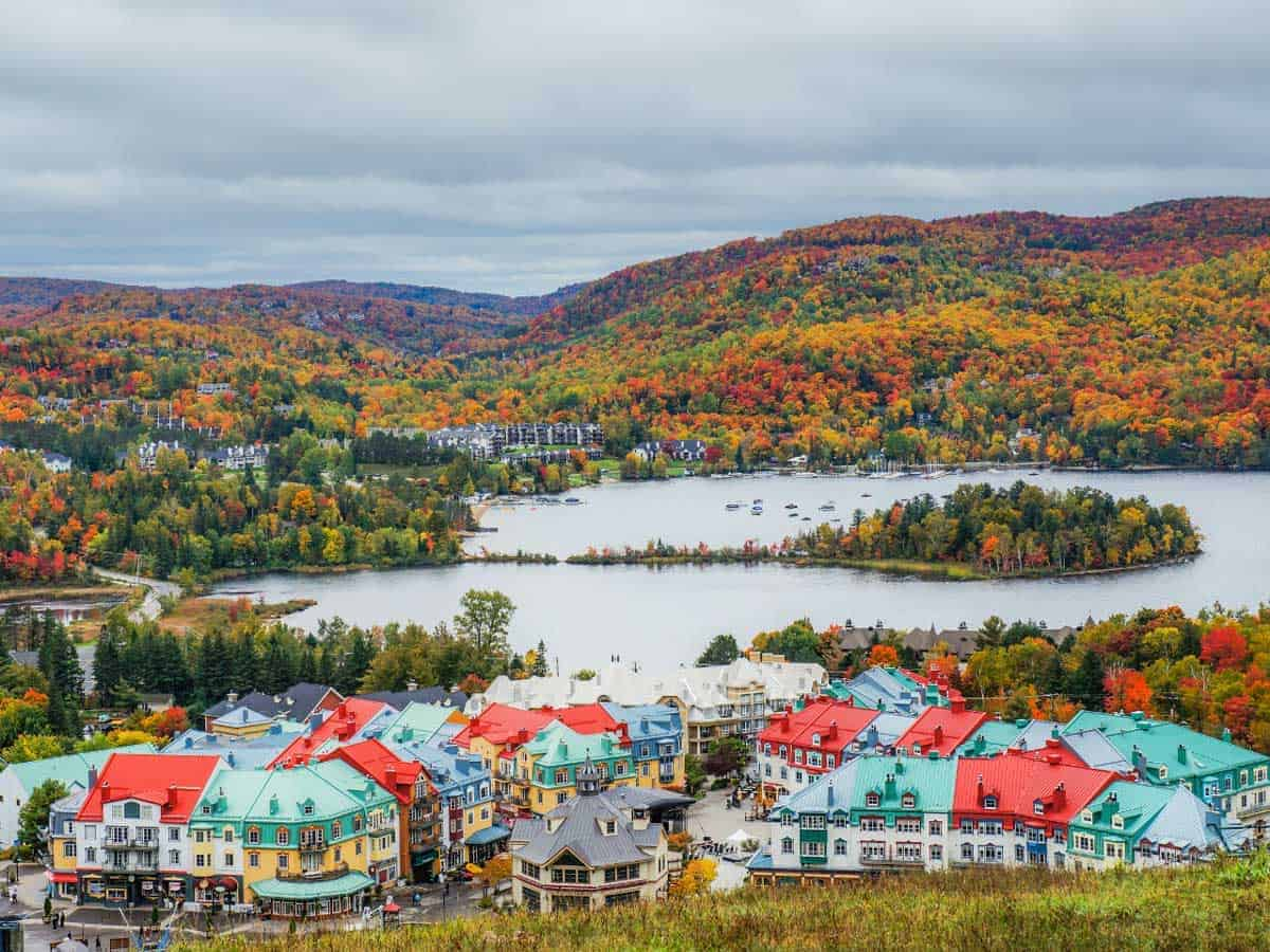 The colourful houses of Mont Tremblant with red, yellow and green the same as the surrounding fall colours.