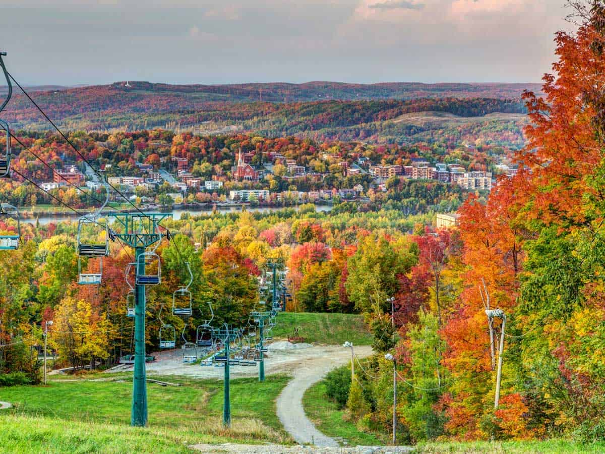 An autumn watercolour, chairlift through the colourful spectrum of foliage in Sherbrooke.