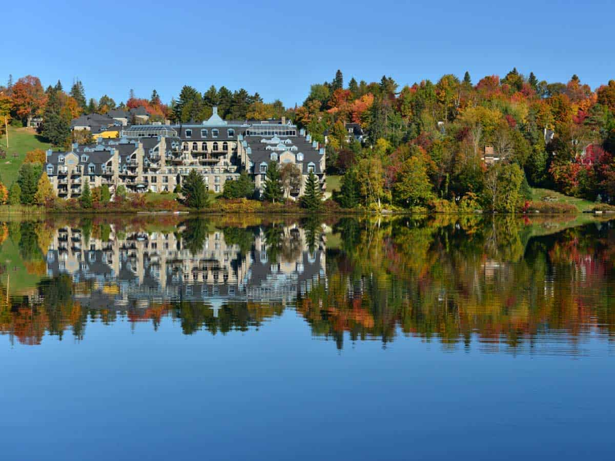 Lake reflections of grand hotel in Sainte-Adèle, perfect place to relax after a fall hike.