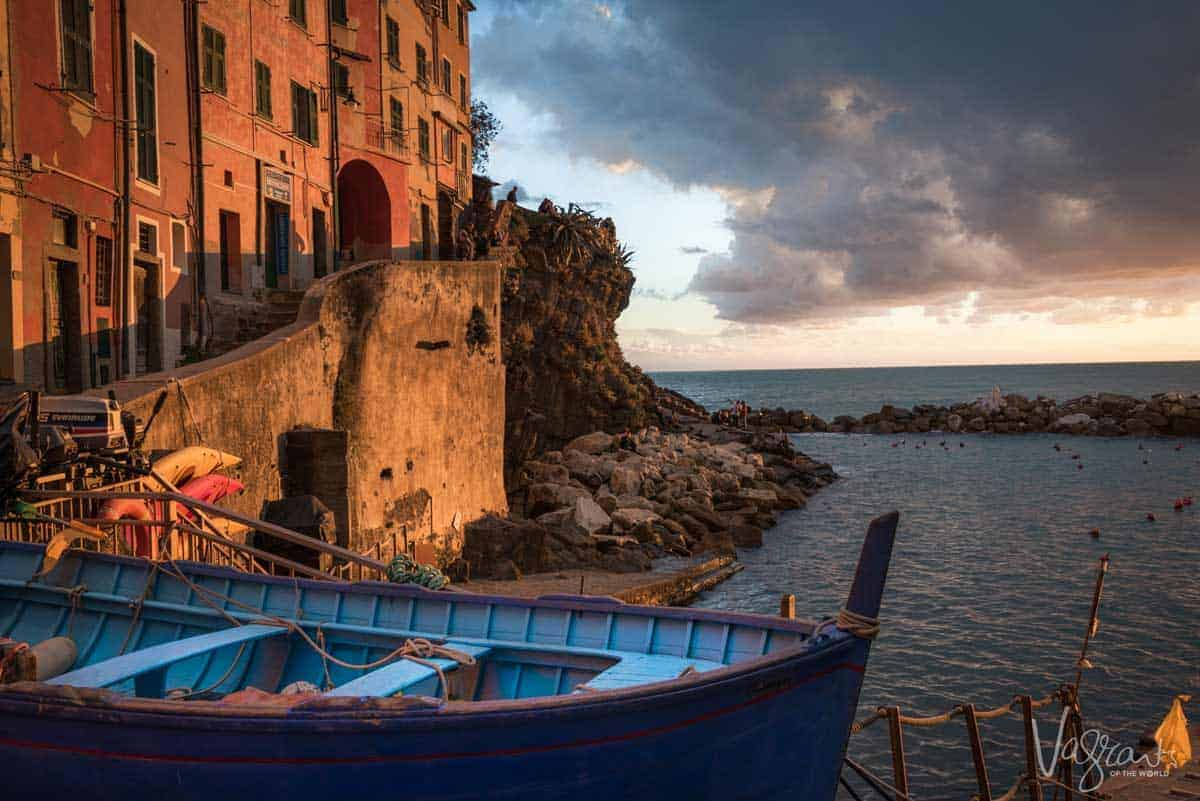 A Manarola sunset on the water with stormy clouds for some extra atmosphere.