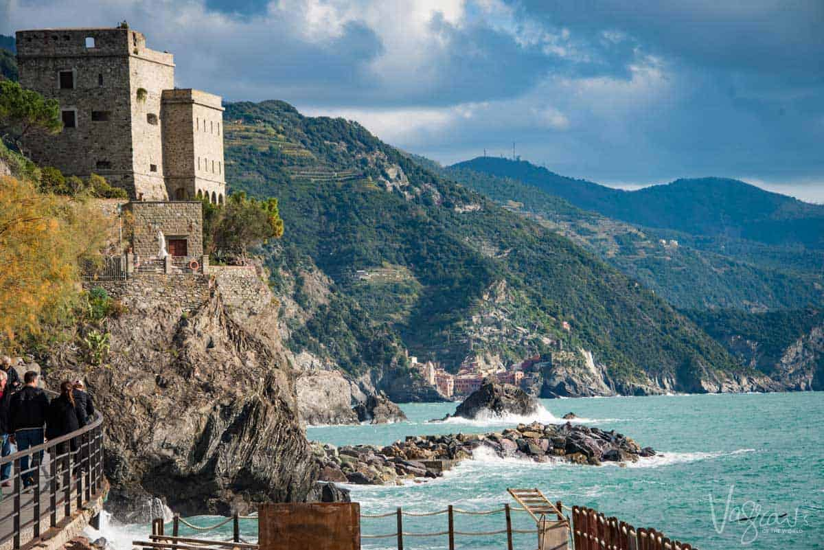 Clouds, castles and a rock shore line a magnificent sight at sunset in Cinque Terre.