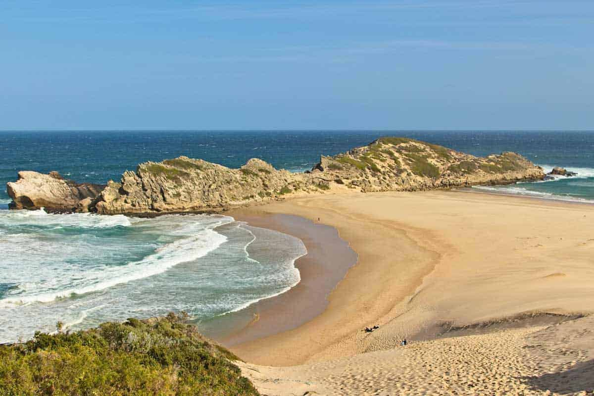 Secluded sandy beach and rocky headland, Plettenberg Bay.