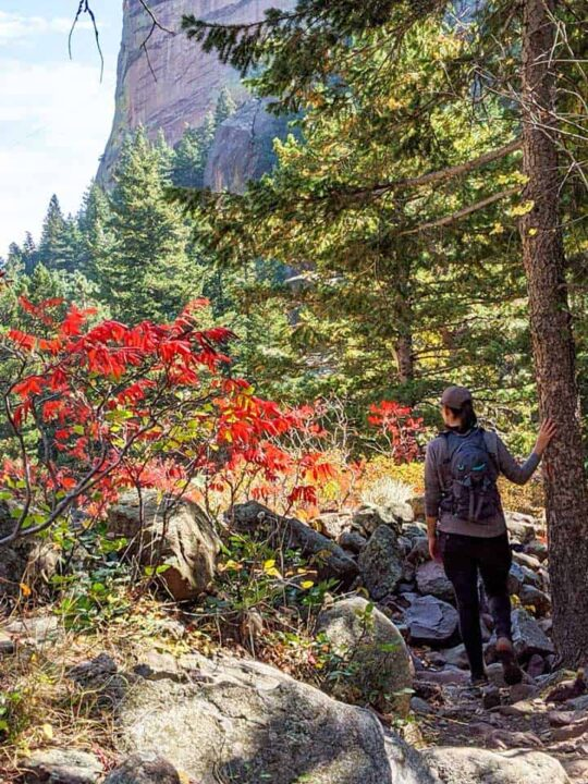 Woman hiking through mountain wilderness in Boulder Colorado.