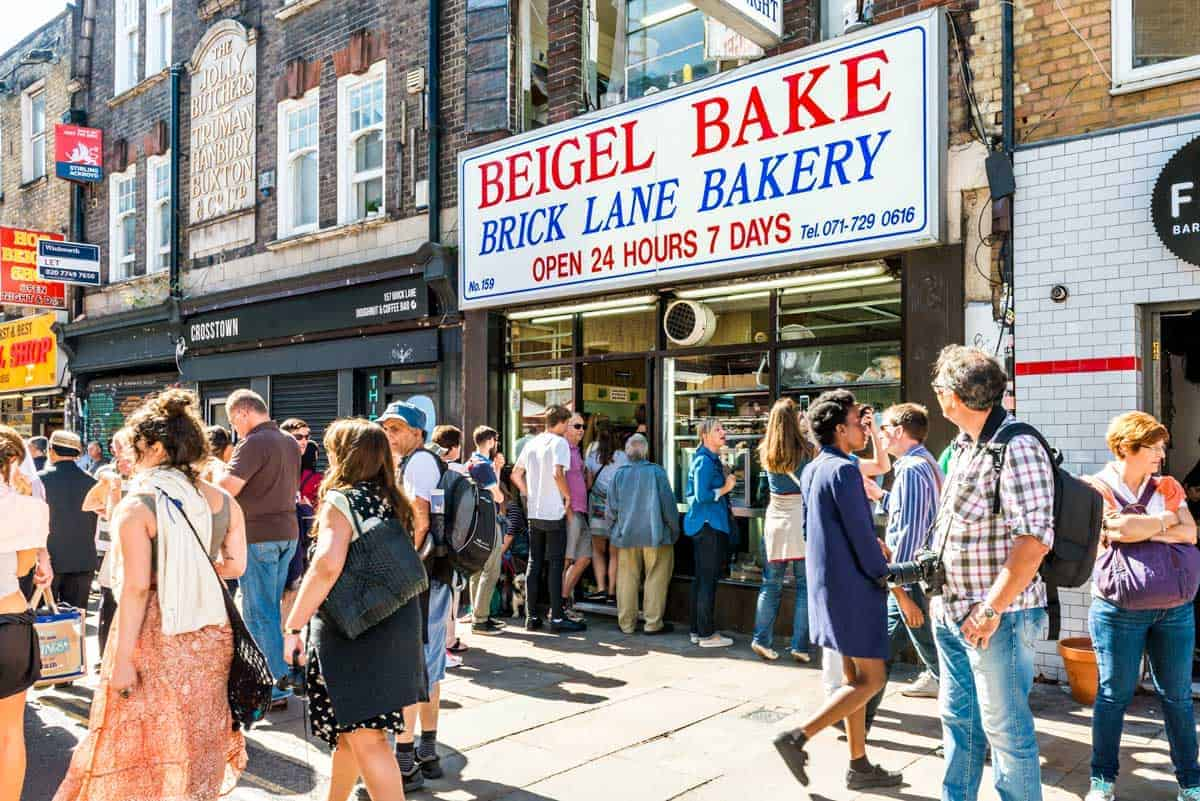 People on the street outside the famous Brick Lane Bakery in London.