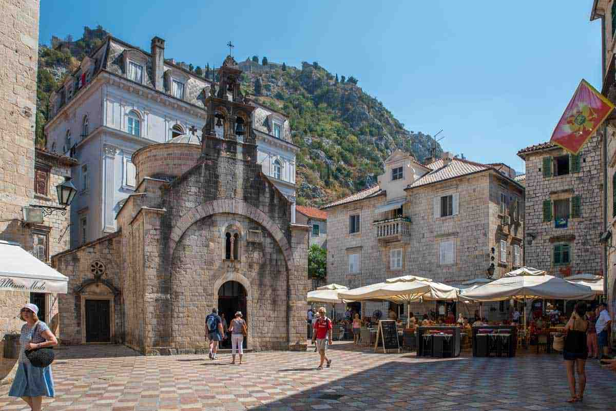 Plaza with church and restaurants in Old town Kotor Montenegro.