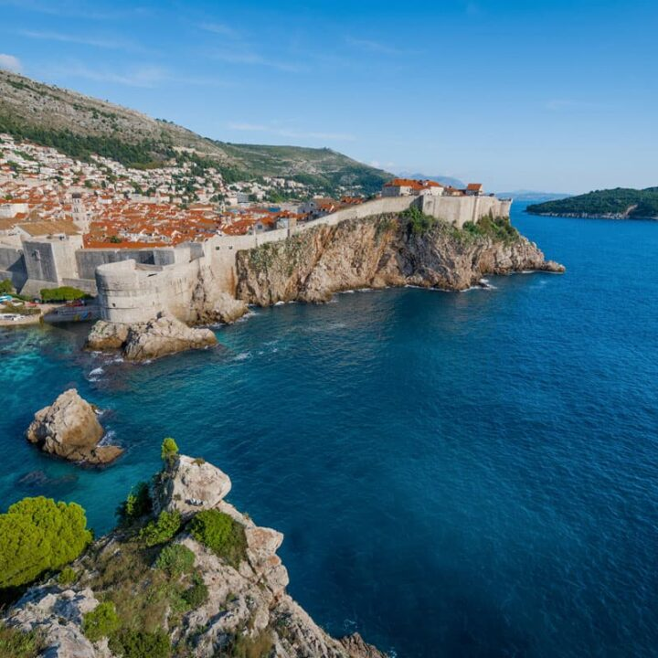 The walled city of Dubrovnik with the contrasting blue of the Adriatic sea.