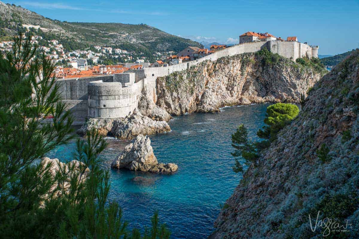 The walled city of Dubrovnik with the blue adriatic sea in the foreground.