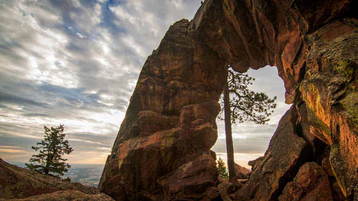 "Looking through the stone ""Royal Arch"" Boulder at a streaky cloudy sky in Boulder Colorado."
