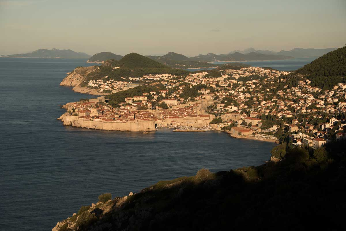 Sunrise over Dubrovnik walled city with the islands of the Adriatic in the background.