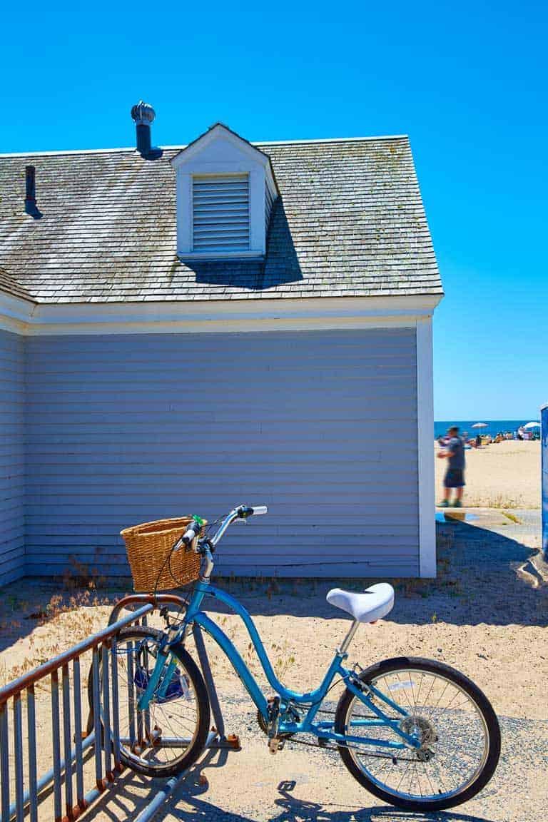 Blue bike parked at the beach at Craigville Beach Cape Cod