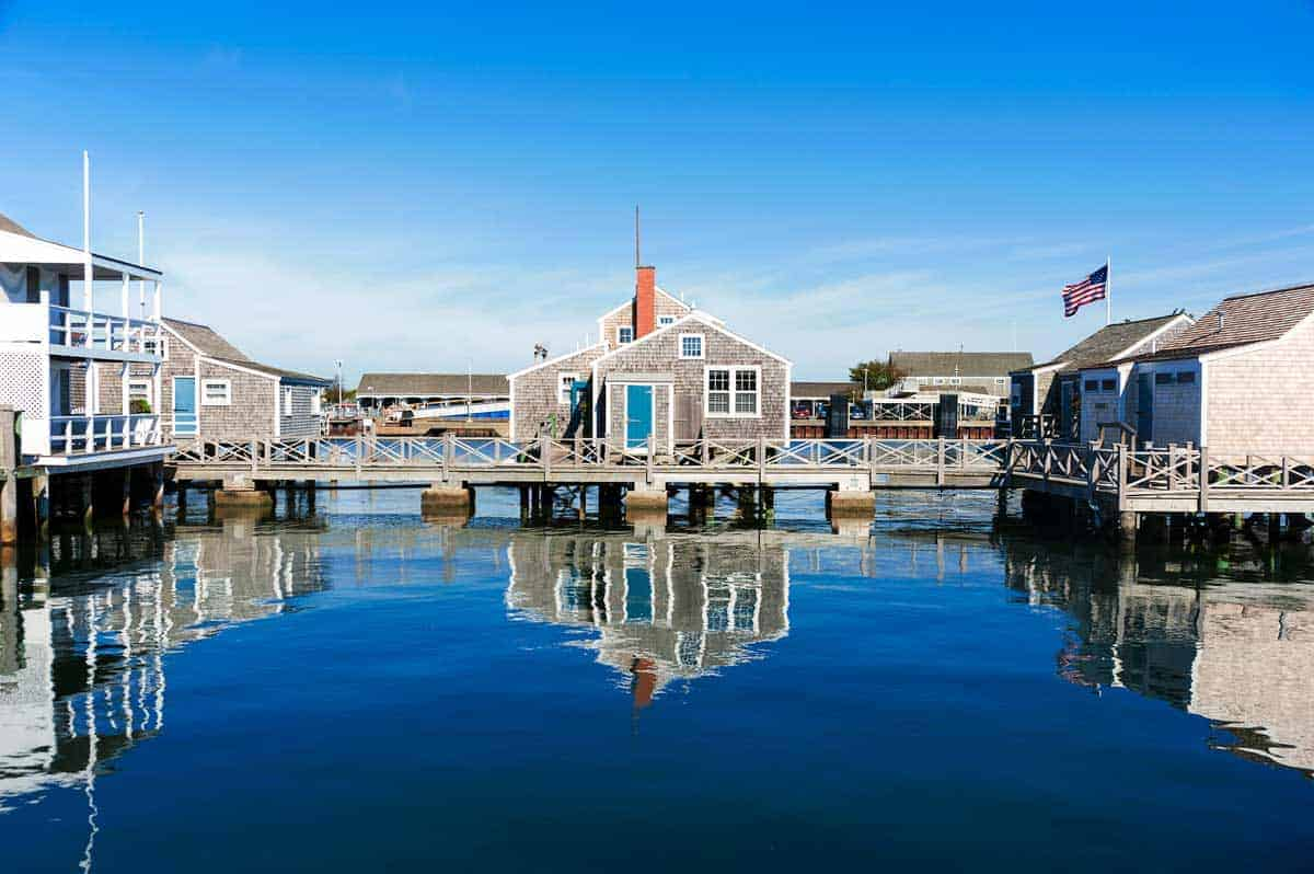 Harbor House reflected in the water in quiet and calm morning in Nantucket Island