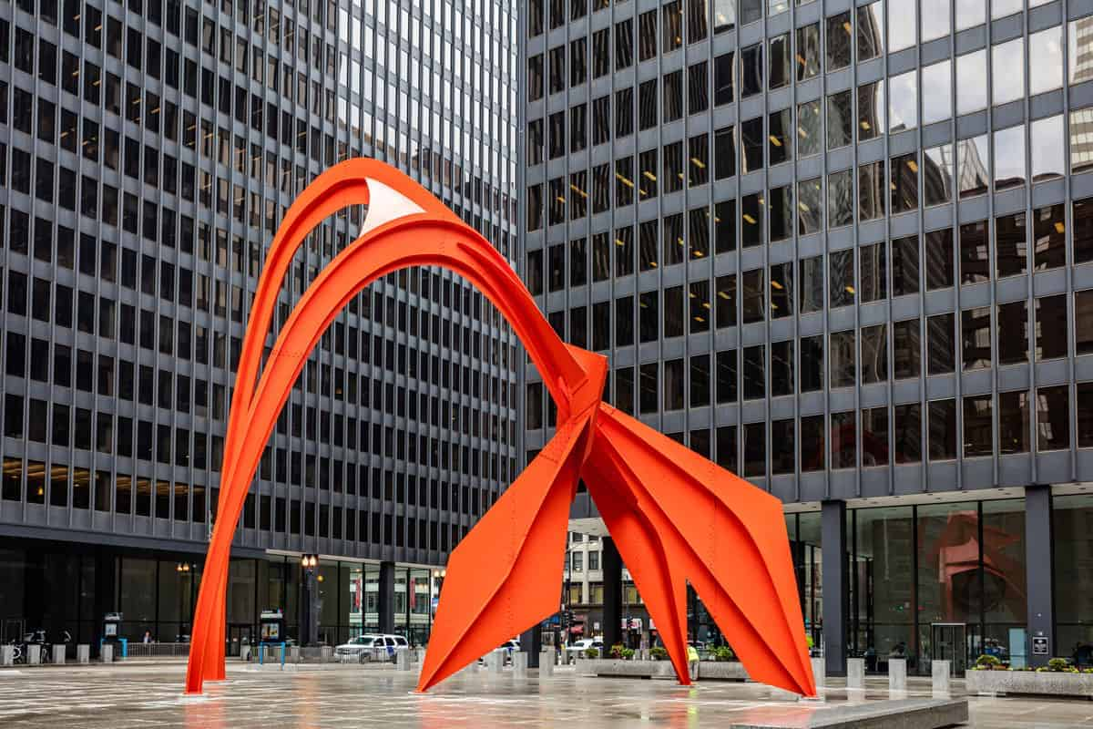 Large red abstract sculpture depicting a flamingo in Chicago.