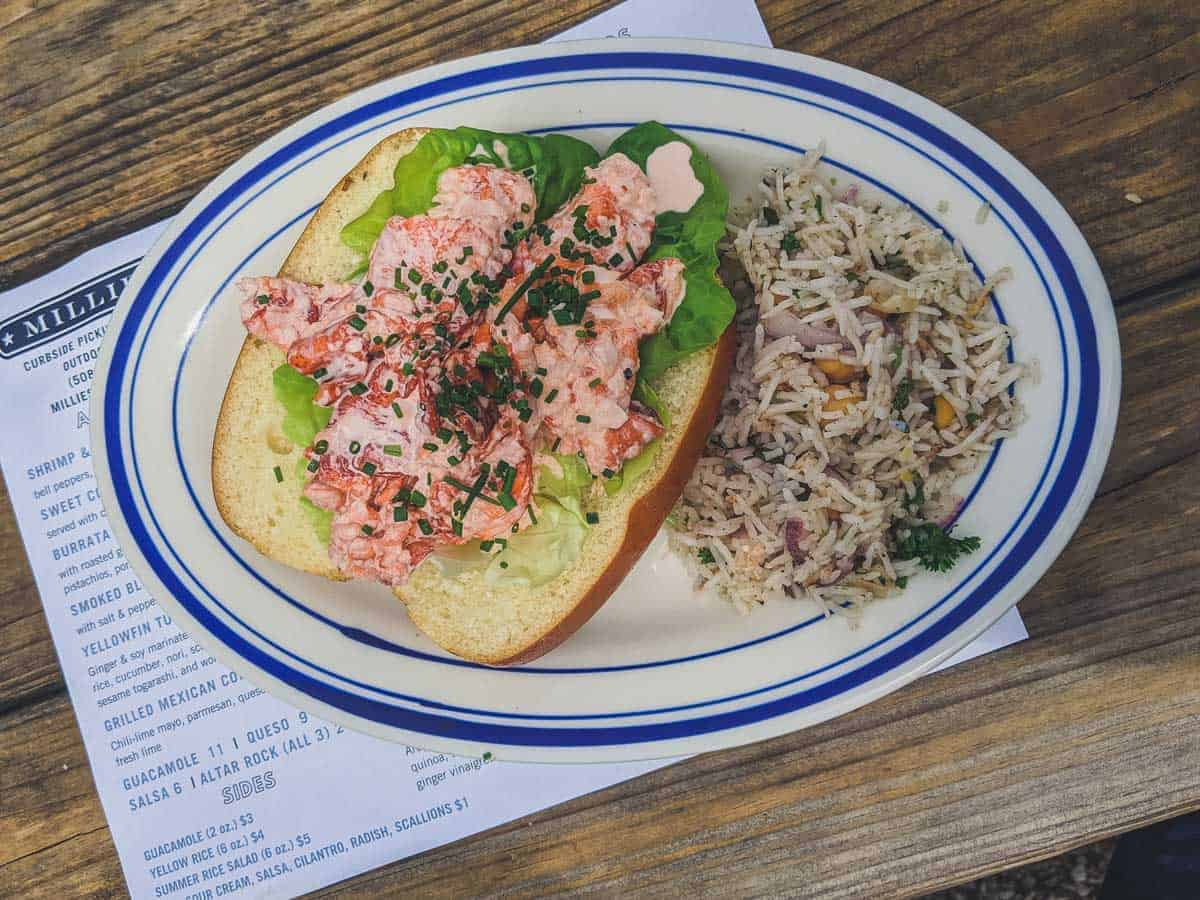 Classic Cape Cod Lobster roll with a side of rice.