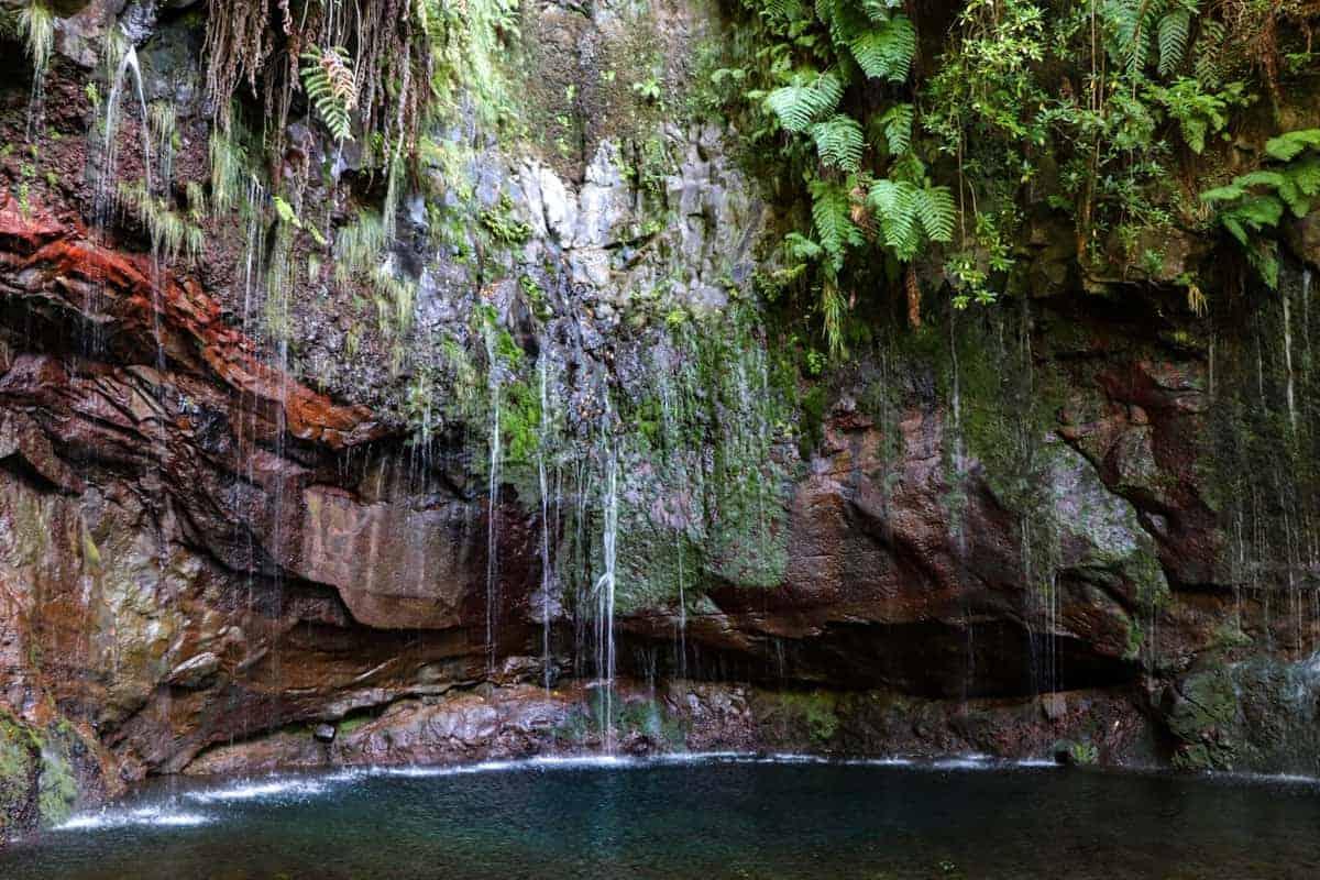 Waterfall over a lagoon on Madeira Island Portugal.