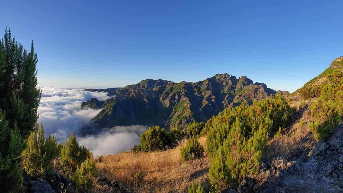 View from above the clouds of dramatic mountain peaks on Madeira Island.