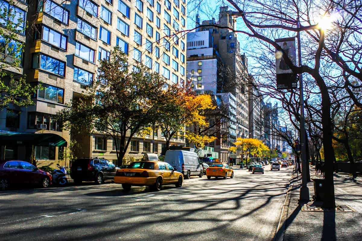 Taxis driving down Fith avenue in New York in fall.