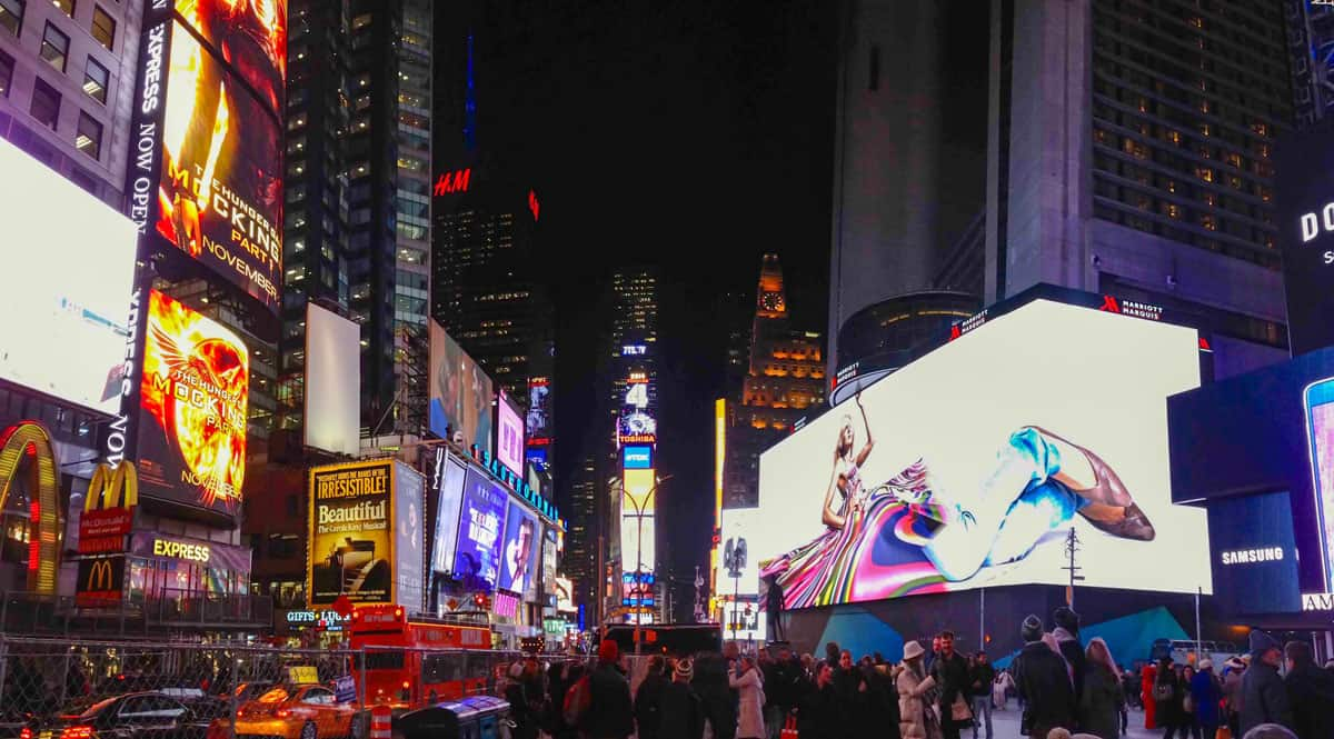 Times Square New York at night all lit up.