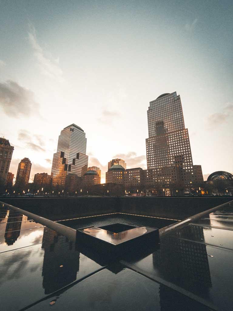 the 9/11 Memorial in New York at dusk.
