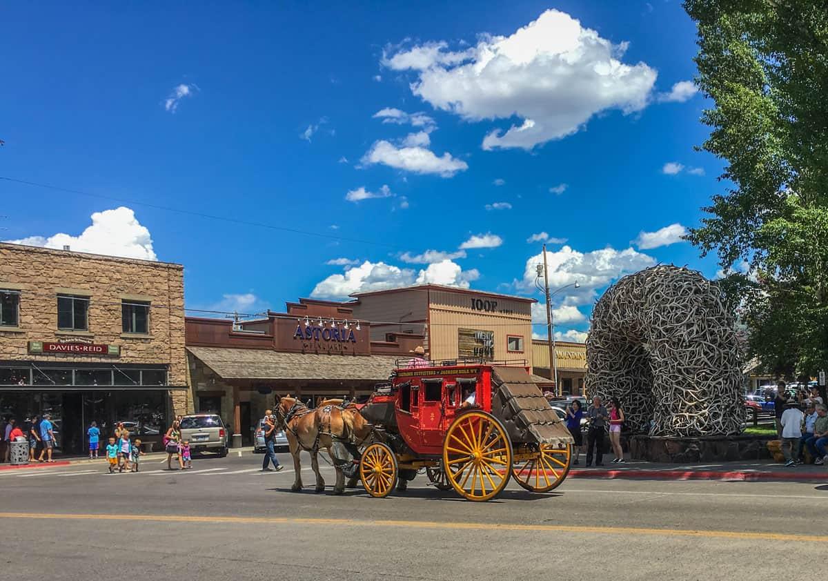 Western style horse drawn wagon travelling through downtown Jackson.