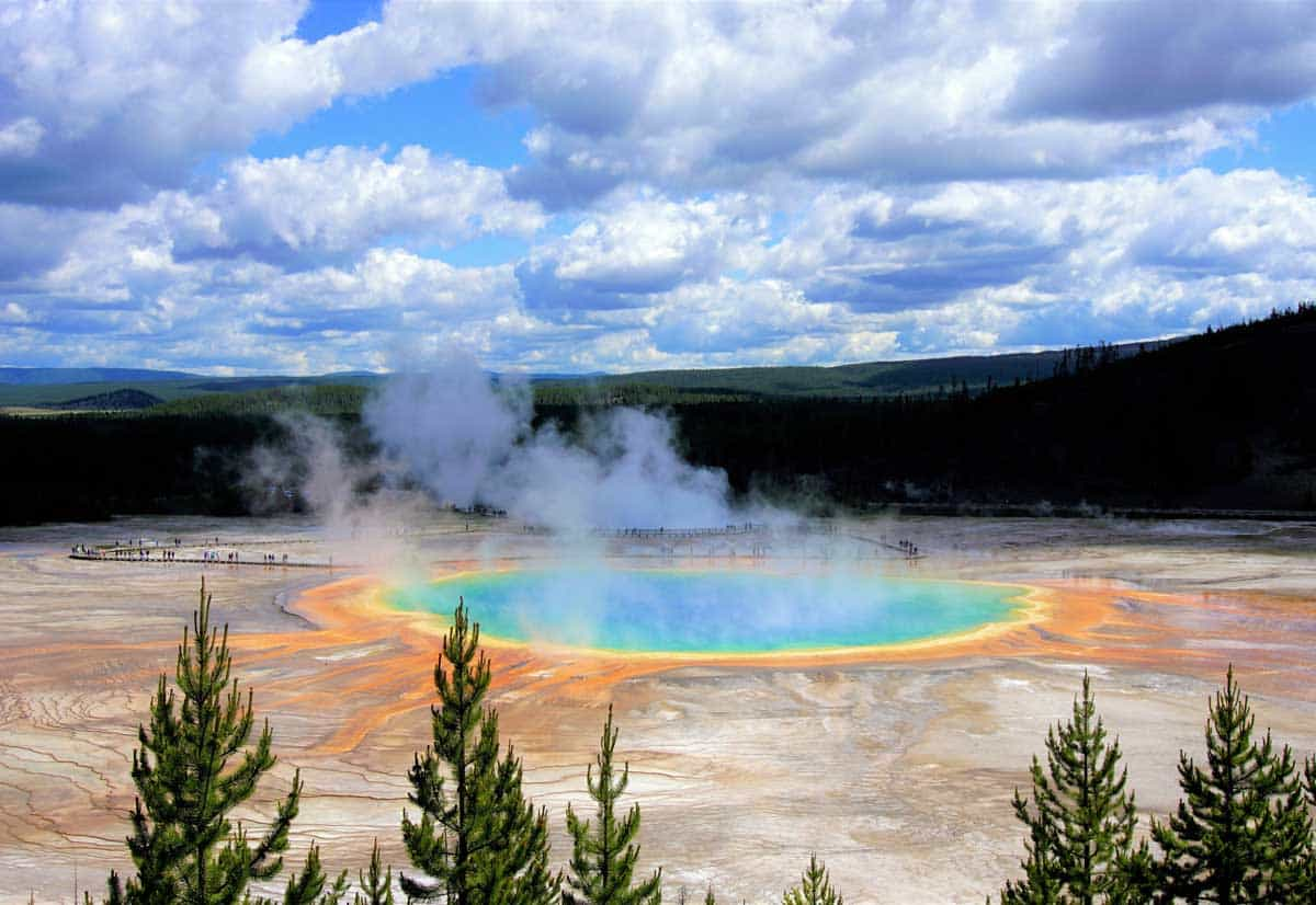 The Grand Prismatic Spring in Yellowstone National Park with thermal steam and brightly coloured water.