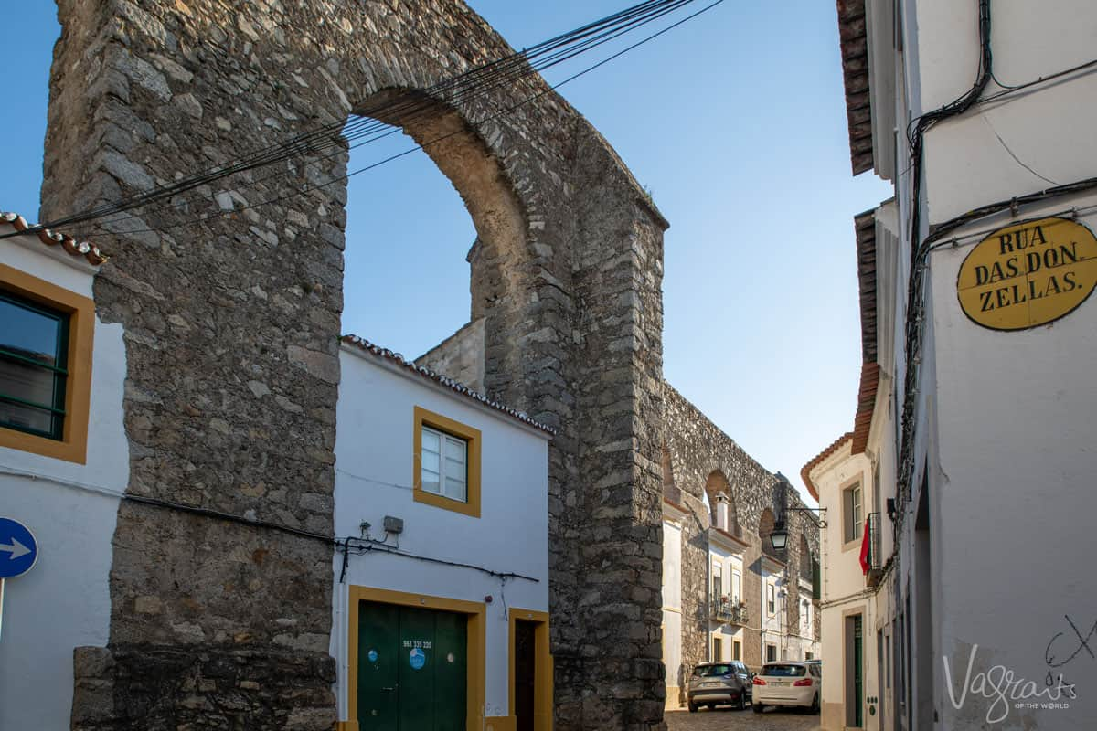 The streets of Evora with houses built into the Aquaduct.