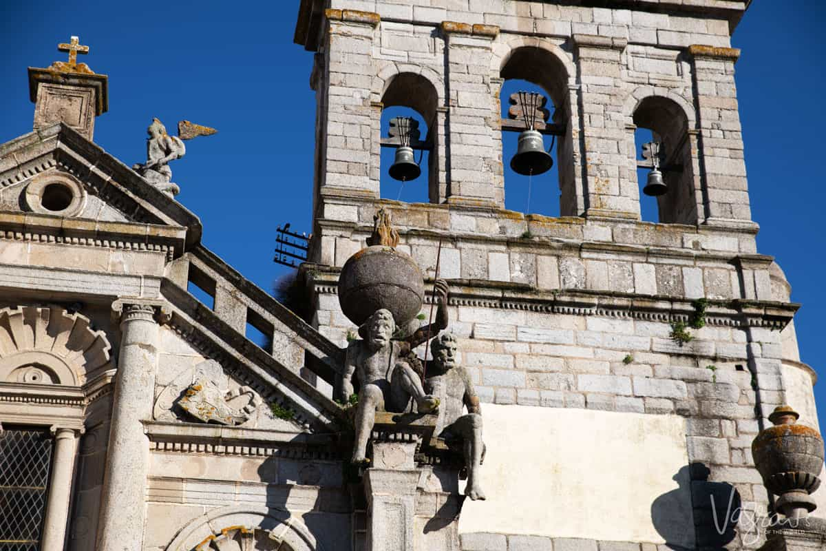 Church facade and bell tower in Evora Portugal.