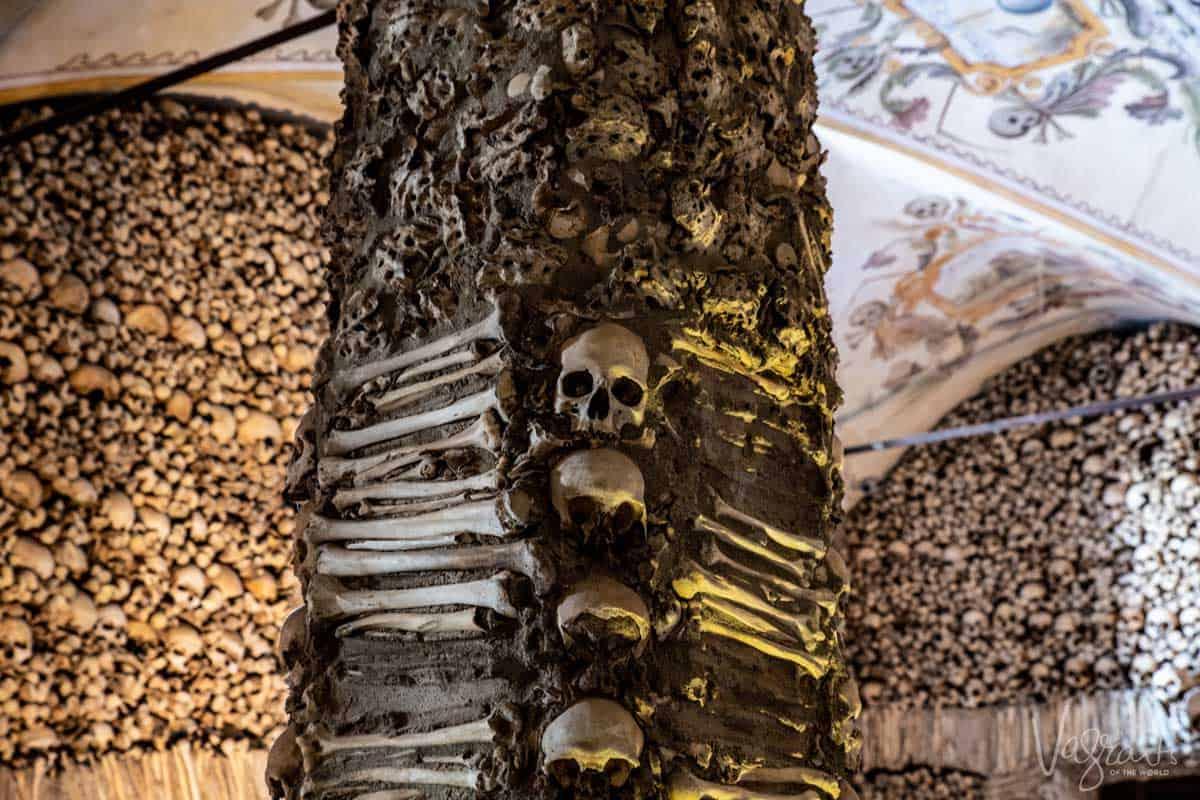 Skulls and bones on the walls of the Capela dos ossos in Evora Portugal.