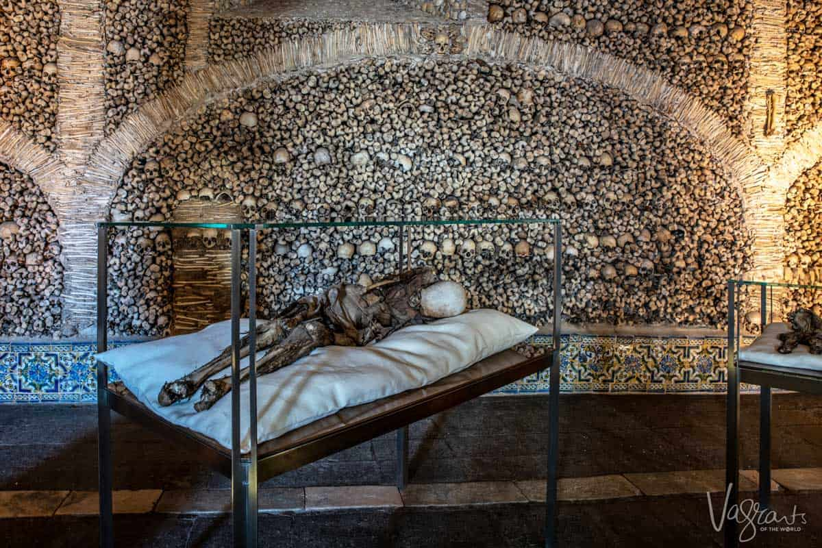 Mummified body on display in the chapel of the bones in Evora.