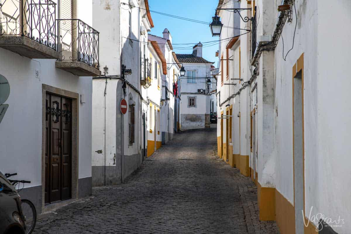 The back streets of Evora old town with typical white houses.
