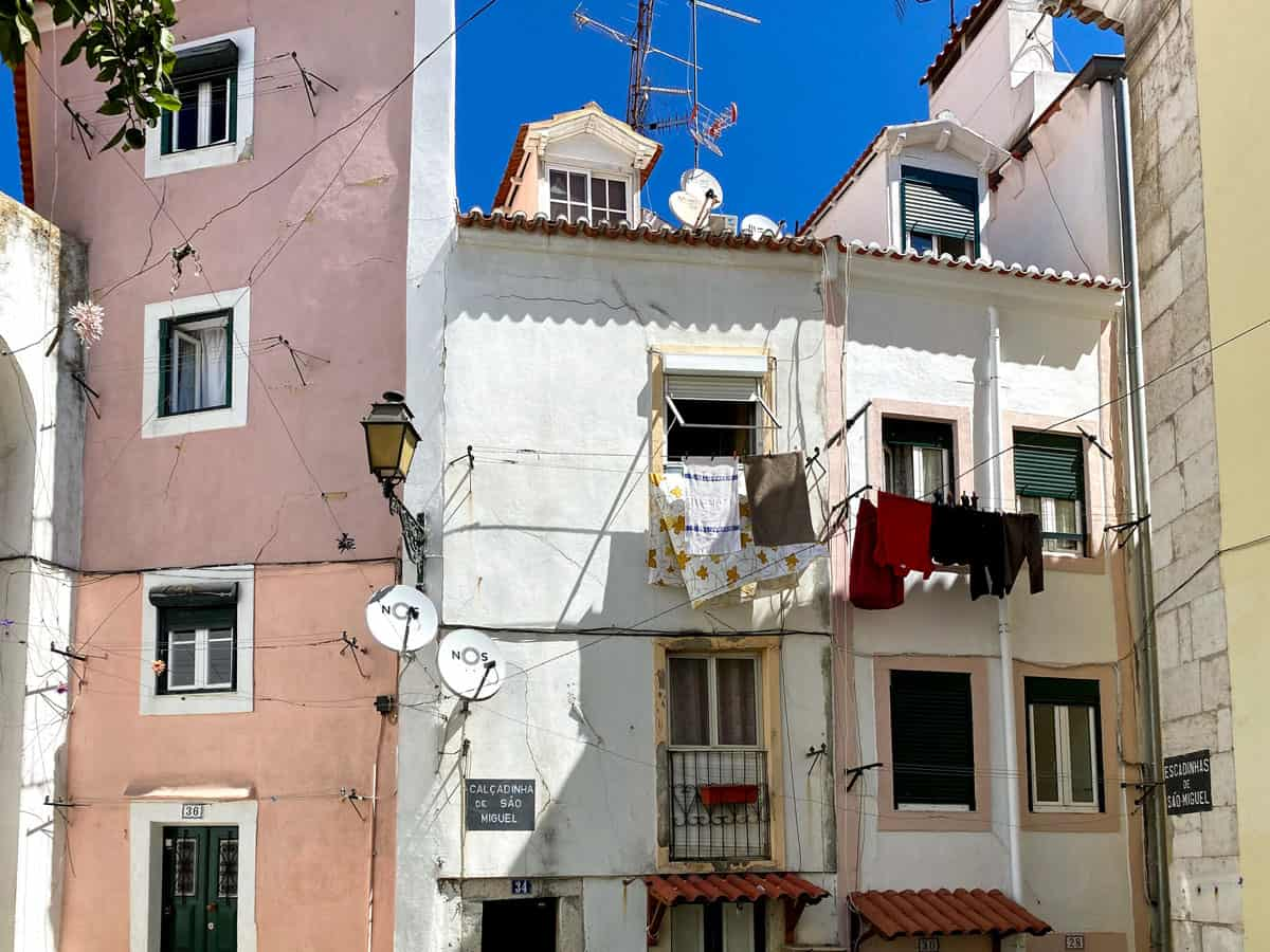 The houses of Alfama in  Lisbon with washing hanging from the window.