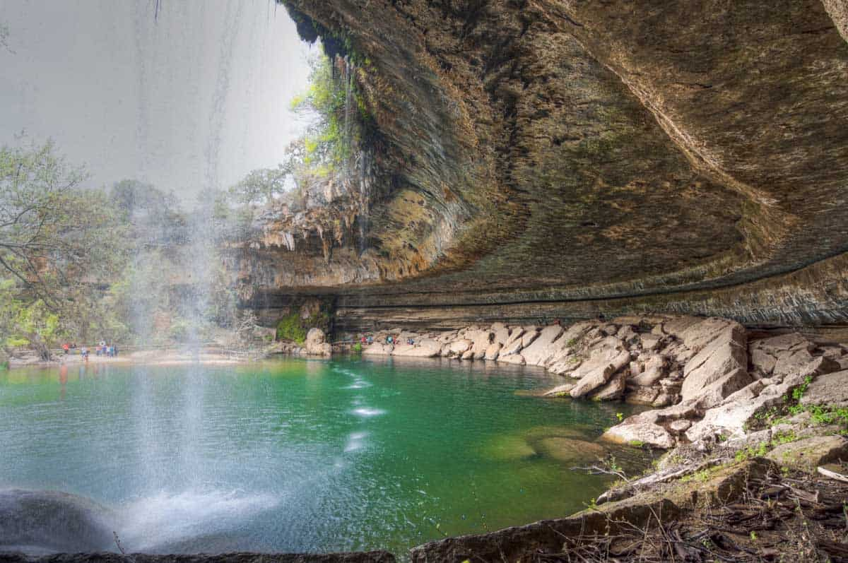 Behind the waterfall at Hamilton Pool Preserve in Dripping Springs Texas.