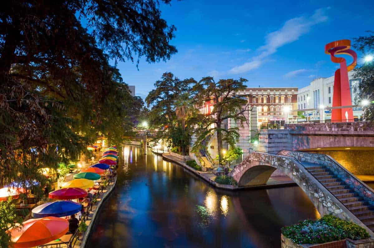 The colourful San Antonio River Walk at night.