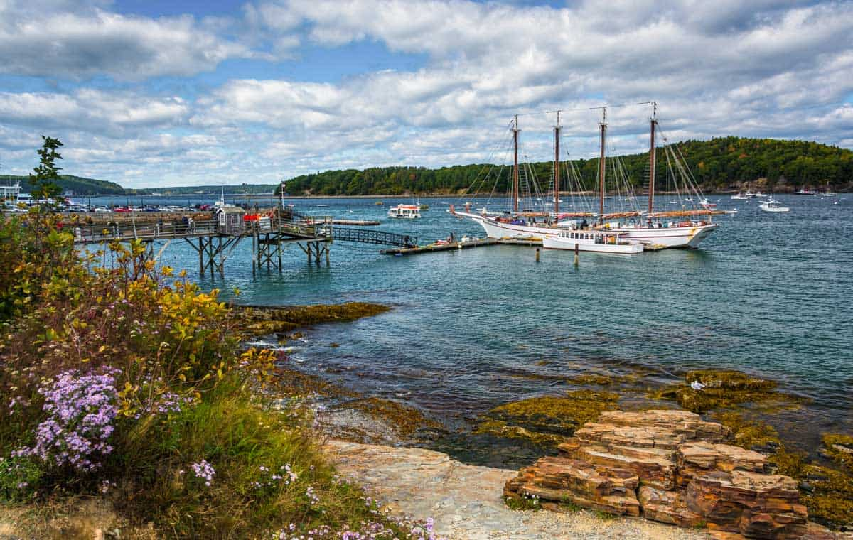 A windjammer tall ship moored at the end of a jetty in Maine.