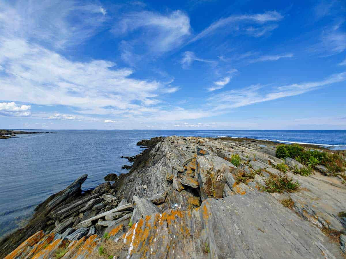 Views out to sea from the Maine Coastline with blue skies.