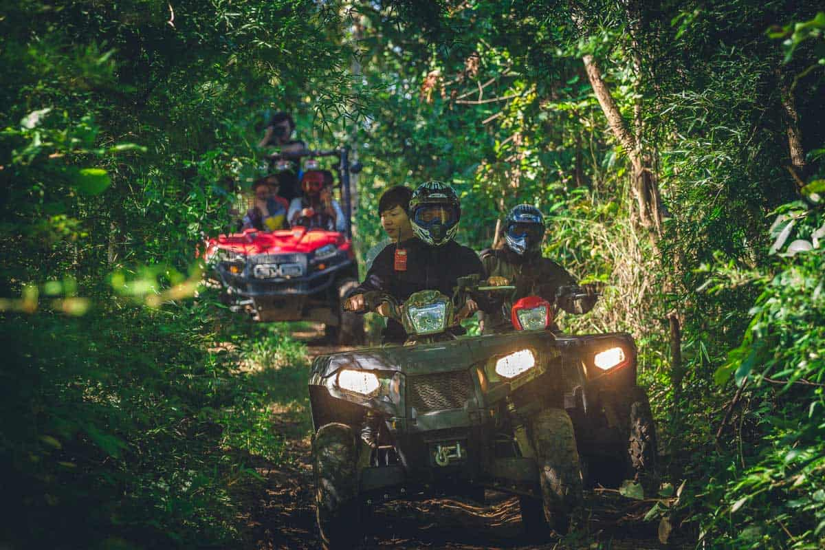 people on an ATV tour in the jungle in Thailand.