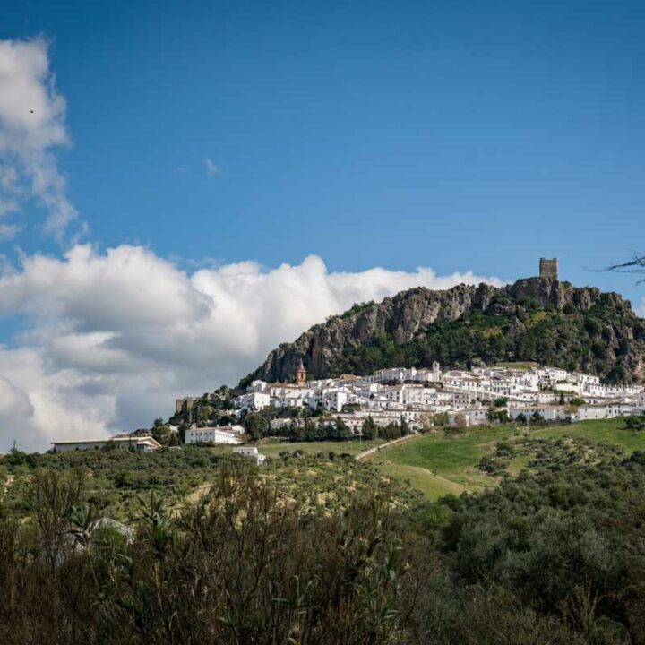 White village in Spain with a castle at the top.