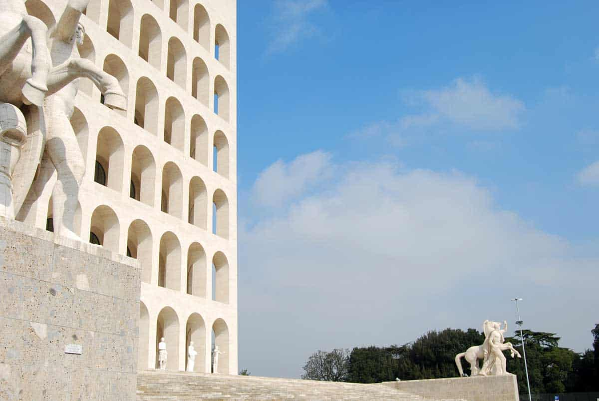 The white marble arched facade of the Palace of Civilisation In the EUR neighbourhood of Rome.