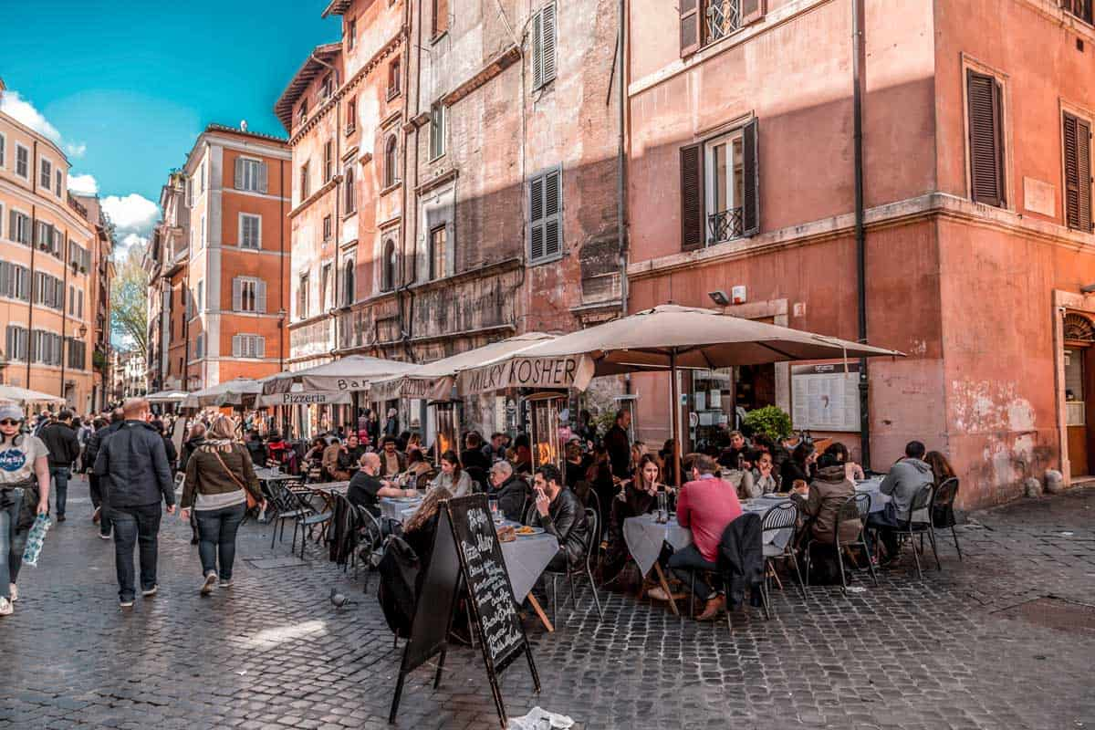 People dining on the street in Kosher restaurants in Rome's Jewish Quarter.