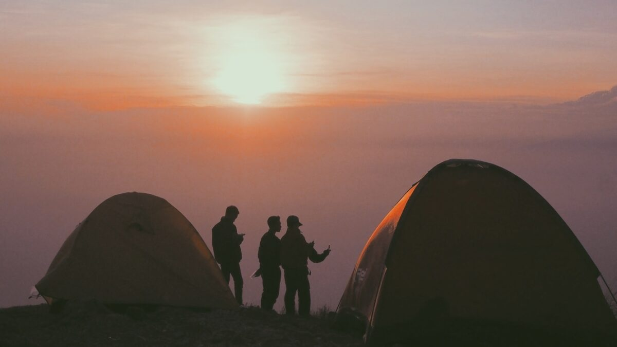 People camping at sunset.