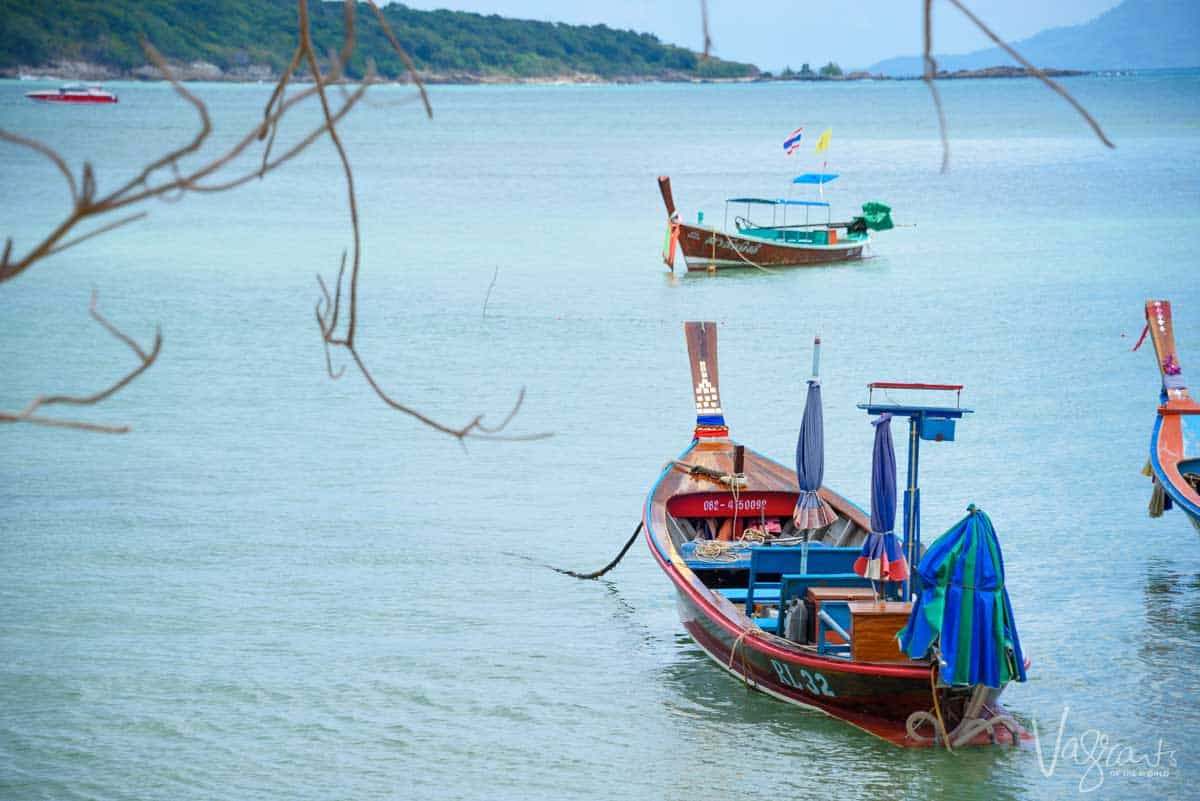 Traditional Thai fishing boat in clear blue water