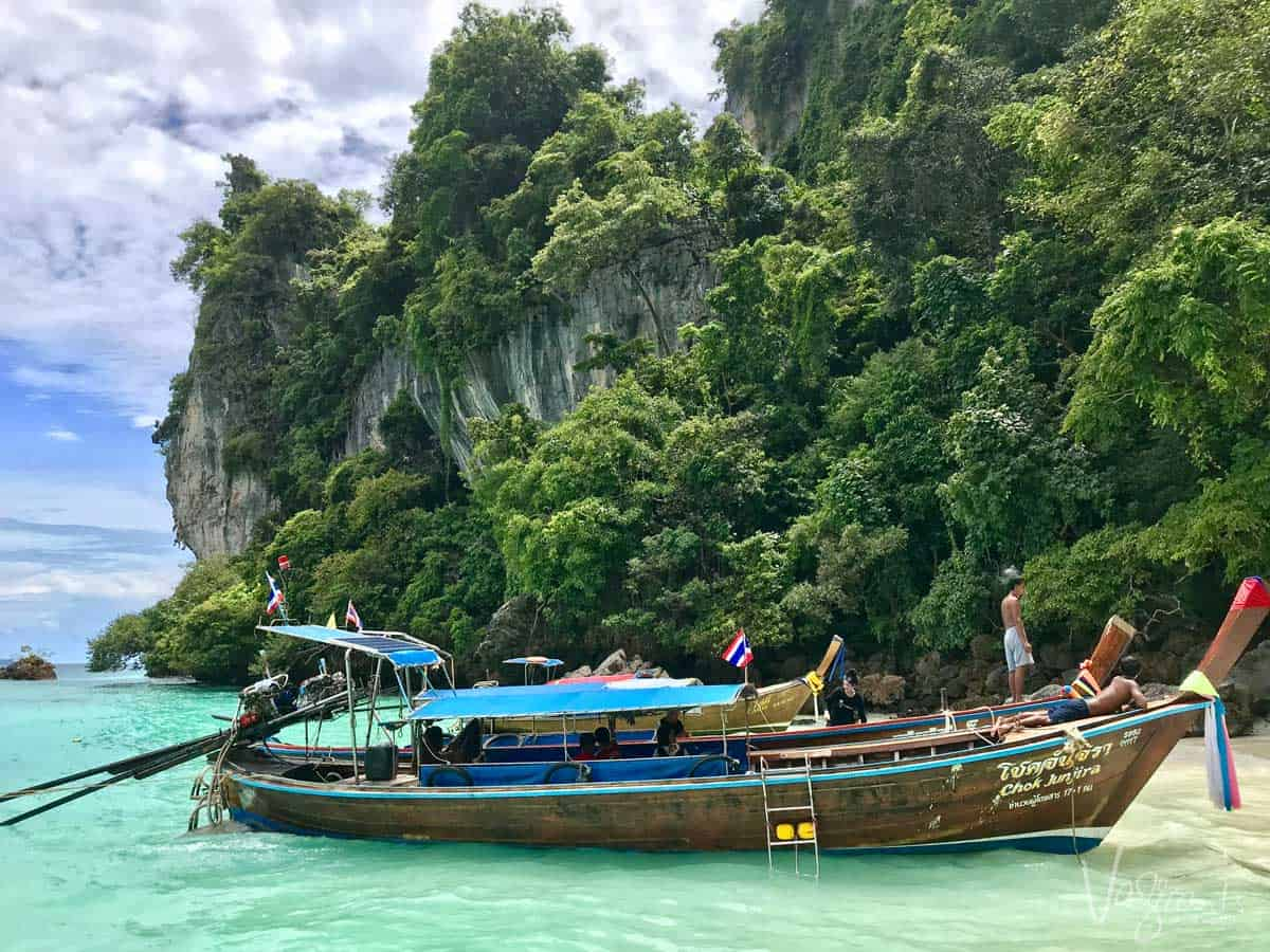 Typical Thai fishing boat in clear blue water.