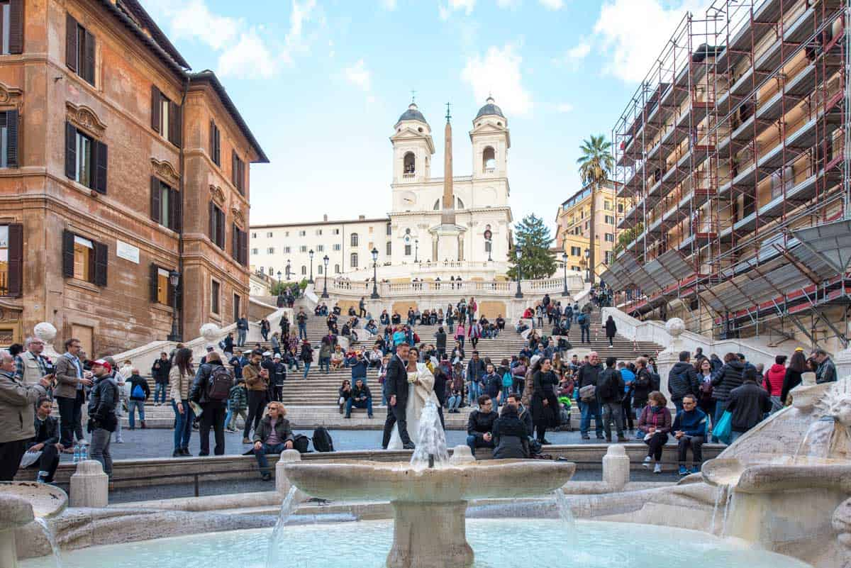 Tourists and a bridal couple in fromnt of the Spanish Steps in Rome.
