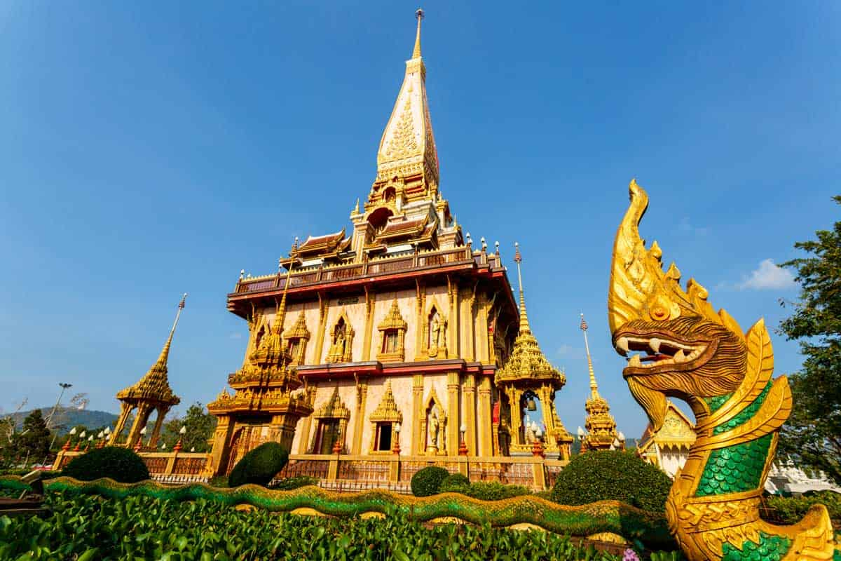 The golden exterior of Wat Chalong Temple in Phuket Thailand.