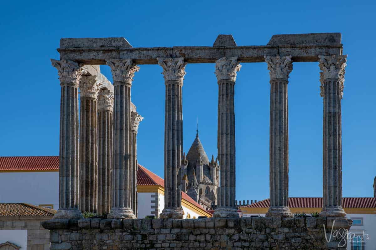 The roman ruins with the Evora cathedral in the background in Évora Portugal.