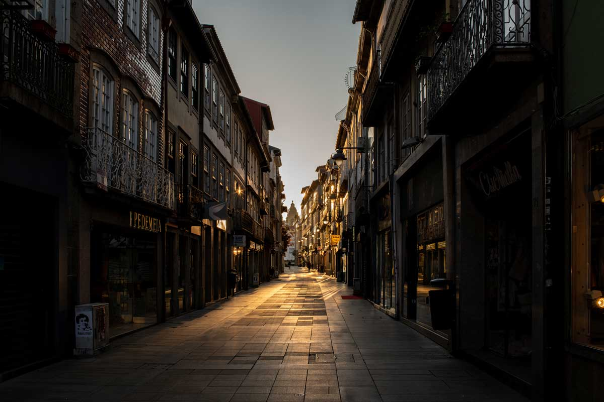Reflections on the main pedestrian street in Braga Portugal at sunrise.
