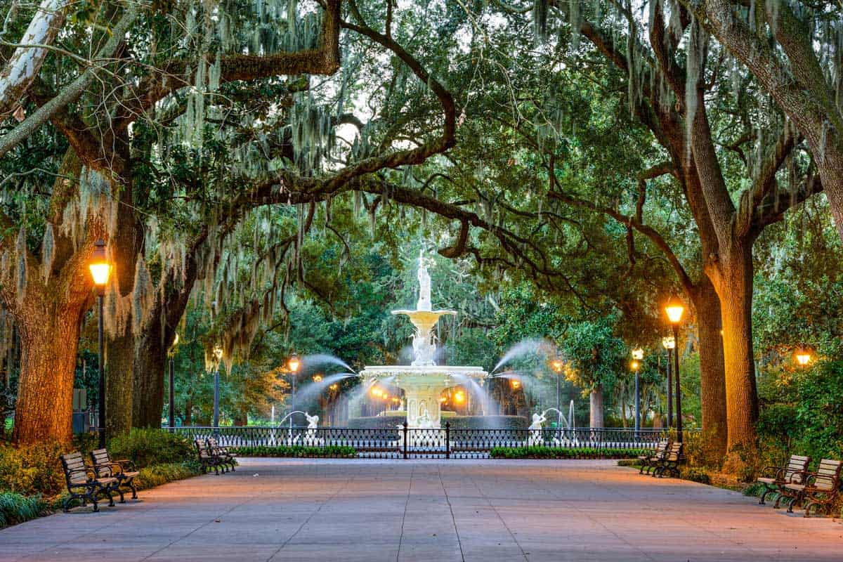 Fountain at the ned of a tree lined boulevard in Forsyth Park Savannah.